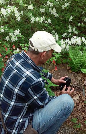 Juan adjusting his camera